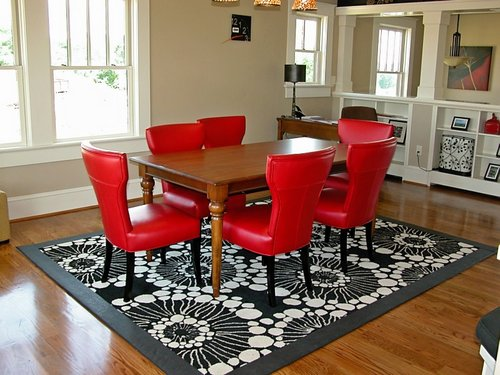 leather-edged-rug-and-red-leather-chairs